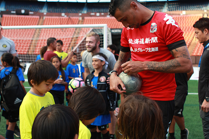 Jay Bothroyd, Soccer Player giving Autograph to Children